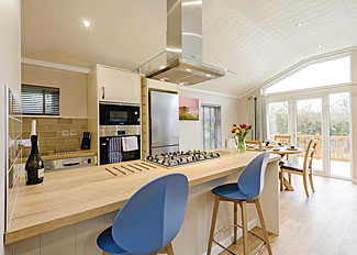 Typical Juniper 2 Lodge kitchen/dining area ( Ref LP14231 ) at Wareham Forest Holiday Lodges - Self catering near Wareham Dorset