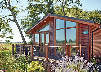 Typical Waterside Spa Lodge ( Ref LP11907 ) Waveney River Centre Holiday Lodge in Norfolk England
