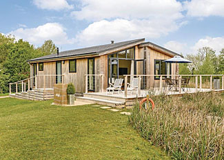 Heron Lodge setting ( Ref LP8708 ) Lakeside holiday lodge at Weybread Lakes in Suffolk England
