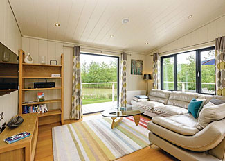 Heron Lodge living area at Weybread Lakes ( Ref LP8708 ) Suffolk Holiday Park in East England