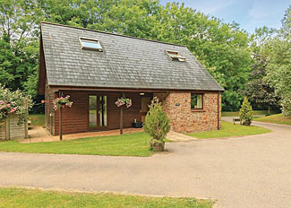 Exterior of Barge Lodge ( Ref LP2674 ) at Whipcott Water holiday accommodation near Holcombe Rogus England