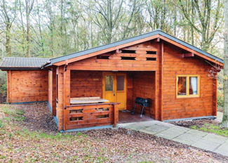 Setting of Woodland Cedar Lodge ( Ref LP5892 ) at Woodland Park Holiday Lodges - Shropshire lodge accommodation near Ellesmere