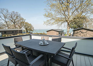 Decking area at Carisbrooke View Premier Lodge ( Ref LP8753 ) Holiday Lodge in Wootton Isle of Wight England