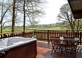 Verandah with hot tub at Hawthorn Spa Lodge ( Ref LP13881 ) Self Catering Accommodation at Penllwyn Lodges Garthmyl Wales