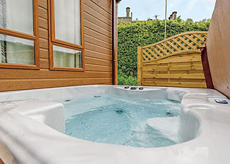 Calthwaite Hall Holiday Lodges - Outdoor hot tub at Aspen - Holiday Home ( Ref LP14439 ) Cumbria Holiday Lodge near Penrith England