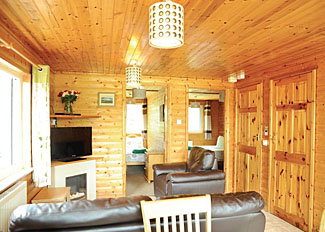Heronstone Holiday Lodges in Powys Wales - Red Kite VIP Lodge lounge area ( Ref LP4651 )