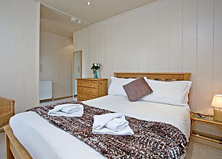 Double bedroom in typical Silver Birch Lodge ( Ref LP8128 ) at Portmile Lodges - Cockwood Holiday Lodges near Dawlish in Devon England