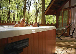 Outdoor hot tub at Golden Oak Hideaway ( Ref LP8066 ) Holiday Lodge at Thorpe Lodges in Norfolk England